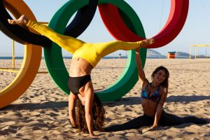 Rio de Janeiro, Brazil. August 1, 2016. Floor acrobatics in front of Olympic rings at Copacabana beach. © Petr Toman/World Sports Images
